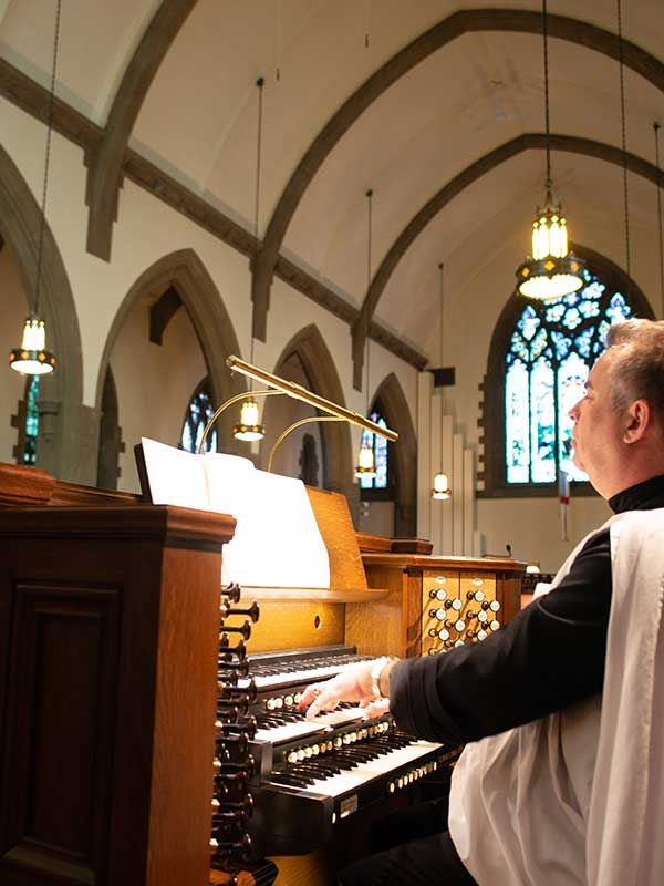 music director playing organ